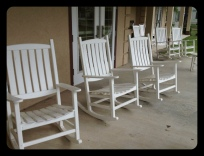 Rocking chairs on the veranda of the community center.